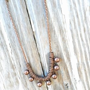 Bronze colored necklace. Short to medium length